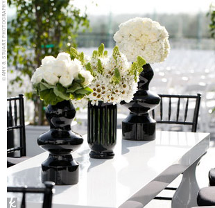 "Colin and Samantha opted for a less formal, more lounge-like reception with a food-station dinner, so Marcy brought in crisp-white lacquer tables and Art Deco-inspired vases for the guests to sit around as they pleased. ""There were enormous amounts of celebrity guests that felt comfortable and stayed really late,"" she says. ""It was fun to see Bruce ..."