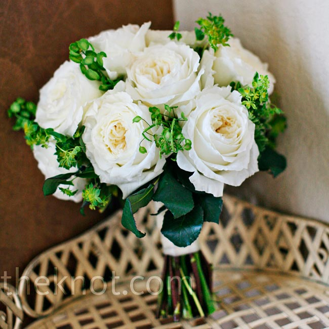 After the peony shipment came in looking lackluster, the florist saved the day with a lush bouquet of white garden roses.