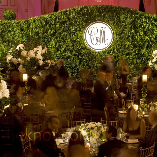 David gave the ballroom of The Plaza a secret garden feel by constructing full hedge walls around the perimeter of the dining area for this New York City wedding.