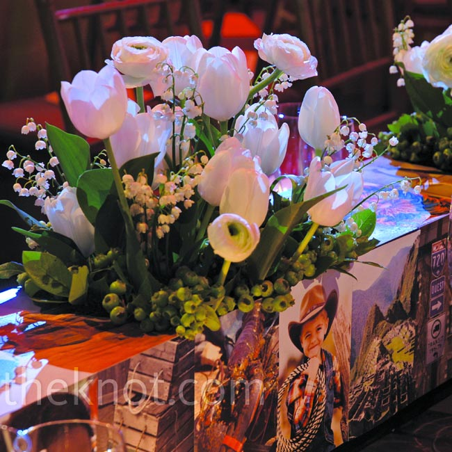 Continuing with the photo mosaic theme, David created covered flower planters to run the length of the tables.