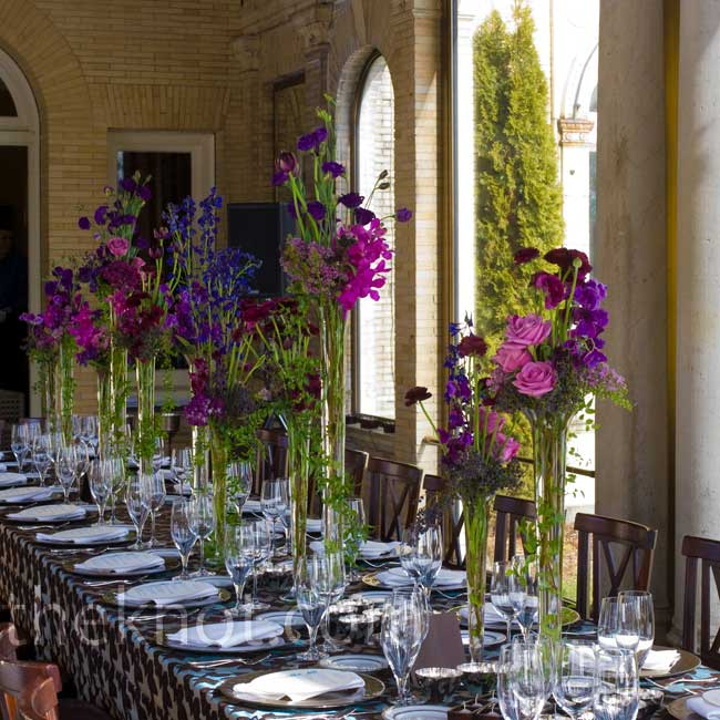Tall sprigs of wildflowers are a refreshing take on spring centerpieces and work especially well at long banquet tables.  Photo: Cheryl Richards Photography