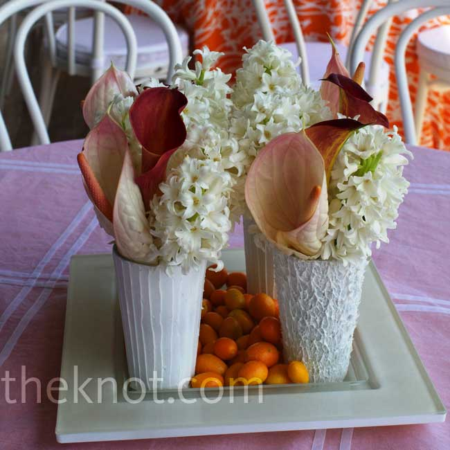 Perfect for a bridal shower or morning-after brunch, these textured vases filled with hyacinths and calla lilies are a unique take on tablescape composition.  Photo: Cheryl Richards Photography