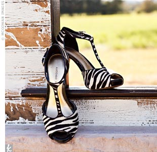 Arly wore funky zebra-print heels for the ceremony and changed into cowboy boots for the reception.