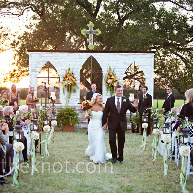 The couple built a wall with Gothic-style window cutouts to mark the altar.