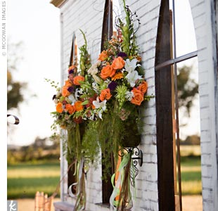 Two arrangements of orange, green and purple flowers made the wall feel like a church in the middle of the pasture.