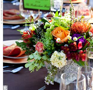 Lower centerpieces of colorful spider mums, lilies and roses decorated some of the tables.