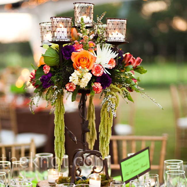 The florist created three different looks for the tables, including a tall one of Voodoo tea roses, parrot tulips, dendrobiums and proteas on a candelabra.