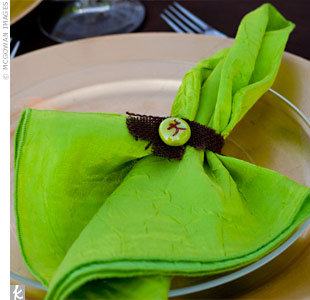 Chartreuse napkins popped against gold chargers and chocolate-brown linens.