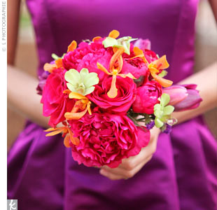 The fuchsia bridesmaid bouquets were made up of tulips, peonies, roses and orchids for a textured look.