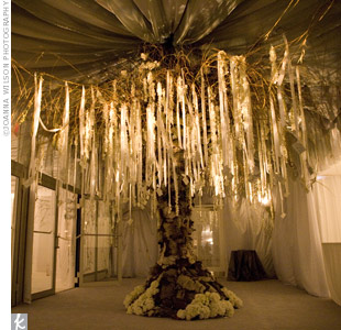 For the wedding of Catherine Zeta-Jones and Michael Douglas, David created an oversize escort card tree, which he says has become his signature design piece. Here he fashioned such an installation but played off the ceiling draping for an all-encompassing entrance statement.