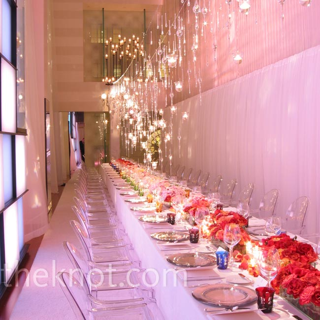 For a Louis Vuitton event, David kept a clean, modern aesthetic with clear ghost chairs, low centerpieces, and hanging crystals and votive candles.