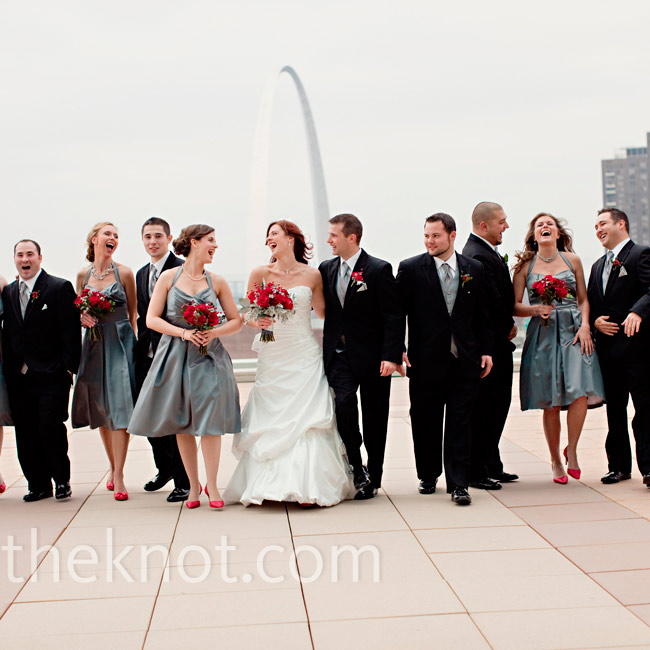 The bridesmaids wore charcoal-gray dresses with halter straps. They also wore matching red heels.