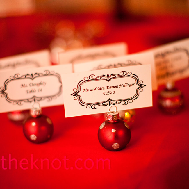 Each escort card was printed with an antique border and held up with a tiny Christmas ornament.