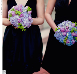 Purple and blue hydrangea and tulip bouquets popped against the bridesmaids' classic black dresses.
