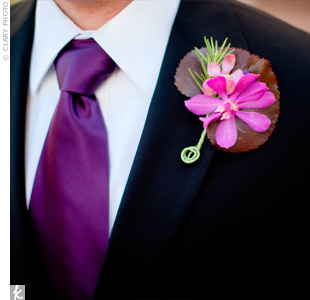 Ryan wore two bright-pink Mokara orchids, accented with a purple statice floret leaf and greenery.