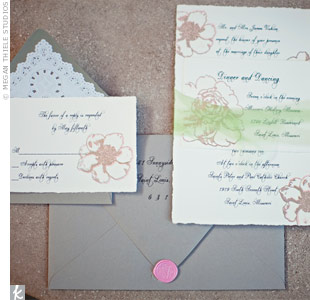 Although the embossed pewter and white invites admittedly took a ton of time to make, Liz was happy with the end result.
