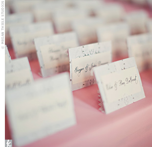 The escort cards were a DIY project: Each was made out of pewter paper and accented with white lace-like doilies.