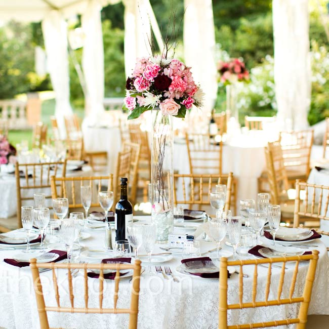 Ivory lace softened the stark-white linens, while elegant vases topped the tables.