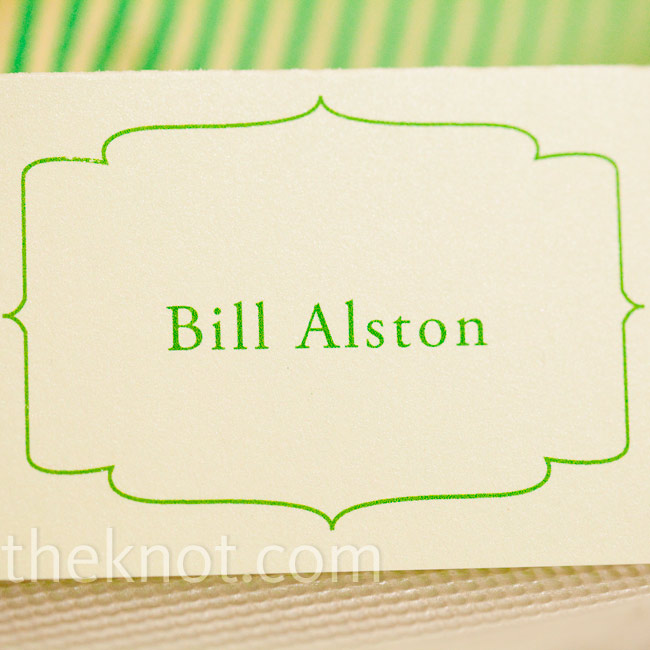 The ivory and lime-green escort cards had the same frame-inspired border as the invitations and other wedding stationery.