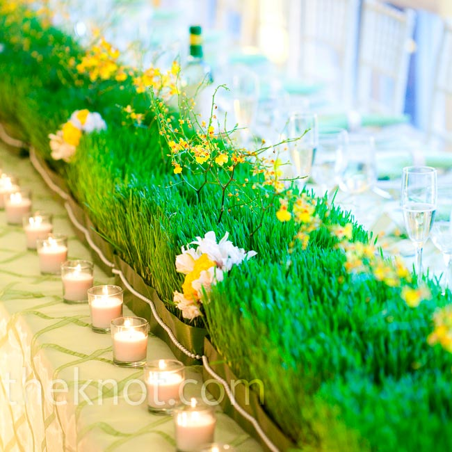 The couple went with something unexpected for their head table—a grass-made runner!