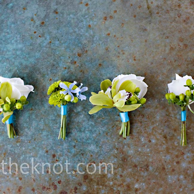 Chris wore a boutonniere of green button mums, while his groomsmen wore roses, orchids and hypericum berries.