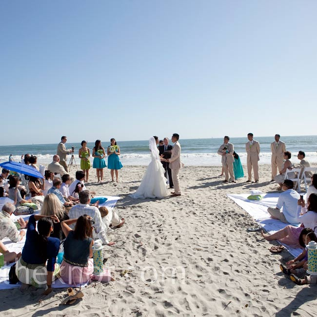 Four king-size sheets served as seating for the beach ceremony, with a few chairs for older guests.