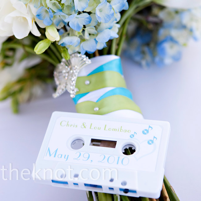 Lou and Chris recorded music onto blank white cassette tapes and labeled them with guests' names and tables on one side and their wedding date on the other.