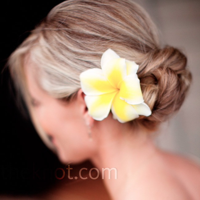 The bridesmaids all wore their hair in low chignon buns with a single flower.