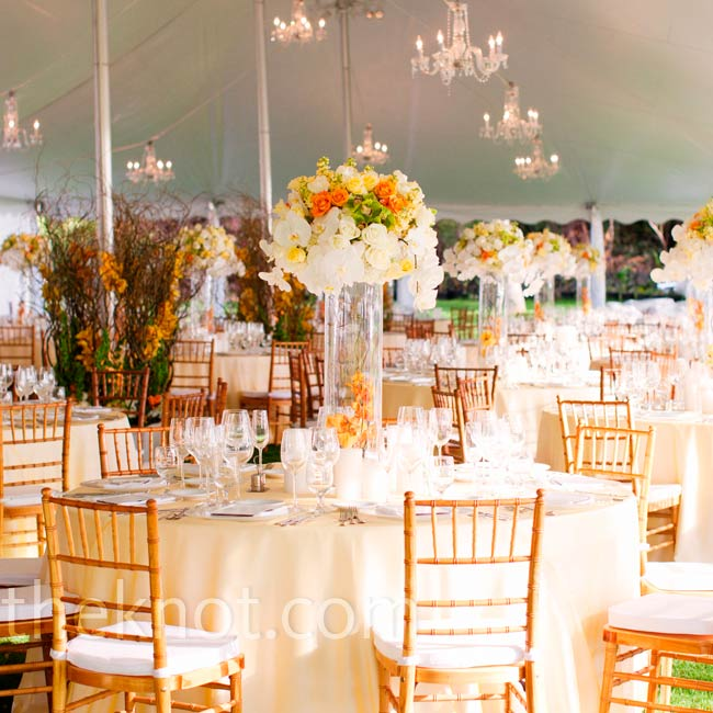 Chandeliers hanging from the tent added a romantic feel, while tall centerpieces and white linens had the simple elegant look Jenny and Christoph were after.