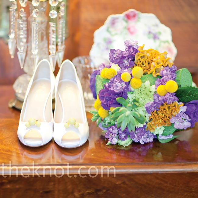 Andrea found vintage shoe clips that matched her palette and mimicked the clusters of yellow craspedia used in all the flowers.