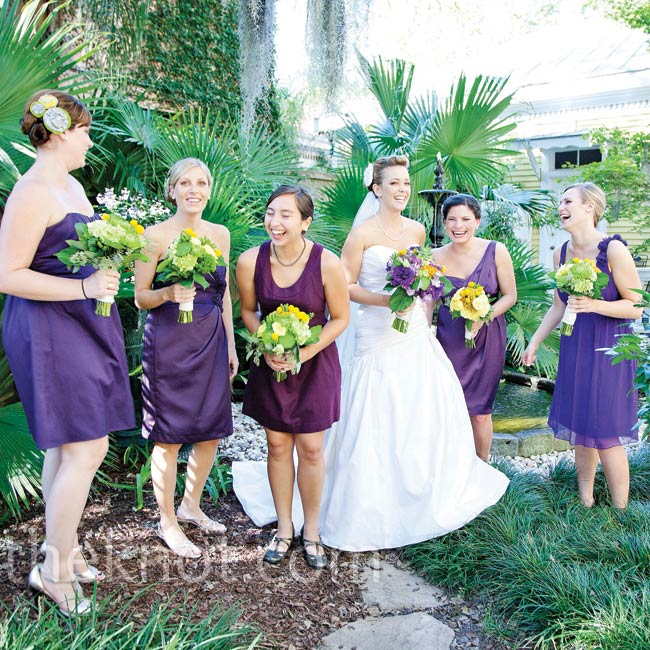 The bridesmaids chose their own dresses, but kept the look cohesive by sticking with dark purple and cocktail length hemlines.