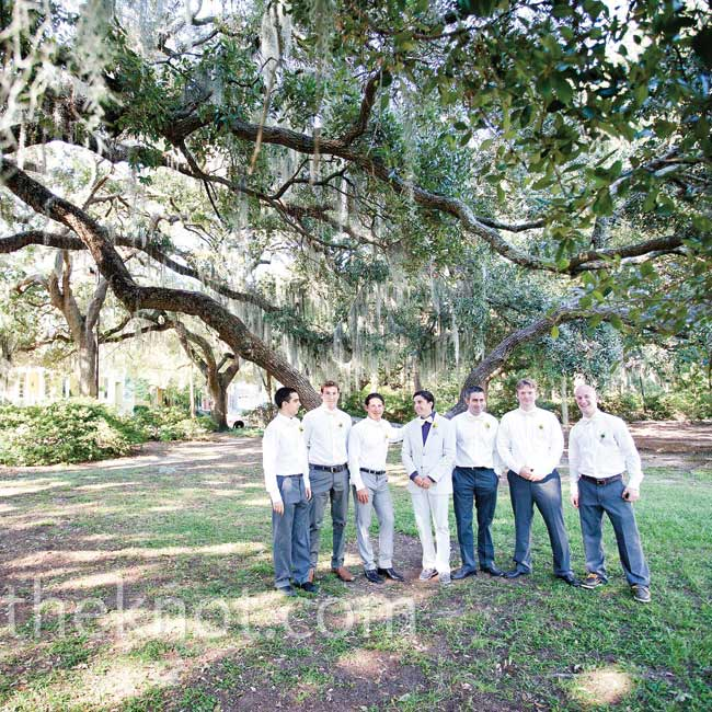 Jon wanted to keep his groomsmen casual, so they wore gray pants with white shirts and handmade bowties.