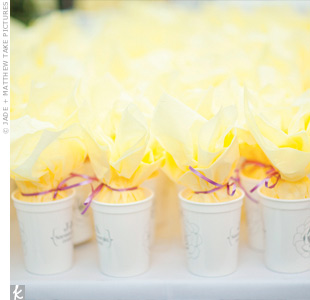 "Keeping with Savannah tradition, the couple made their guests popcorn-filled ""To Go Cups"" designed by the bride."