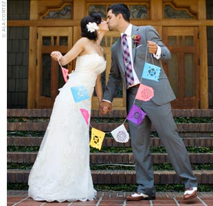 As a nod to the couple's heritage, papel picado banners decorated the reception.