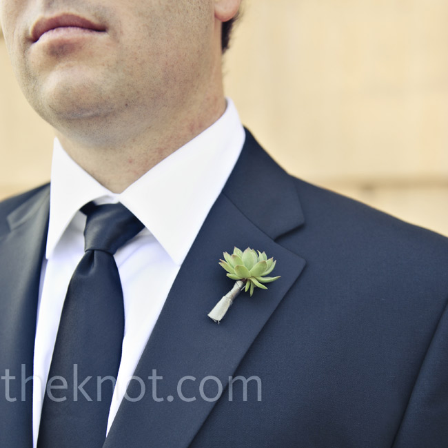 The guys wore tiny succulents on their lapels.