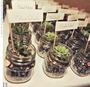 With help from friends, the couple assembled these mason-jar potted succulent wedding favors, which doubled as the escort cards.