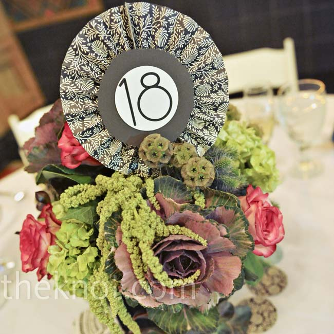 Table numbers were set into the rustic floral arrangements.