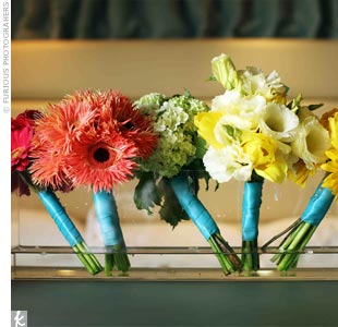 The bridesmaids held small, monochromatic bouquets including gerbera daisies, orchids and hydrangeas.