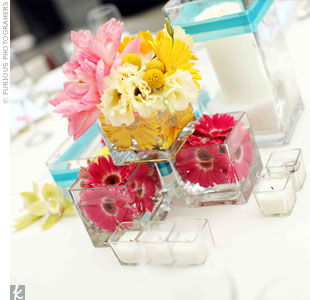 All of the centerpieces were different. On some tables, square glass vases were filled with blooms and stacked.