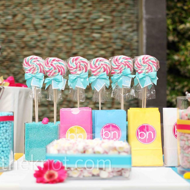 Beth and Nik love candy, so they sent guests home with lots of it -- including pink and blue lollipops.