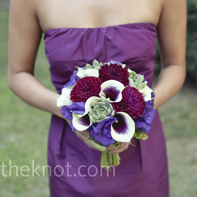 Succulents added a natural look to the girls' bouquets of dahlias and white calla lilies with purple centers.