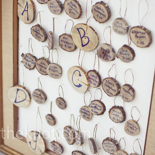 The couple's creative and crafty planner cut out tree-trunk circles (in lieu of escort cards) and wrote guests' names and table numbers on them.