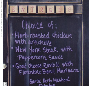 Menu options were handwritten on a vintage door coated in chalkboard paint.