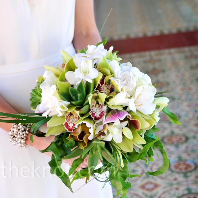 Kira carried a green and white mix of succulents, cymbidium orchids, lady's slipper orchids, rolled lily grass and wave leaf