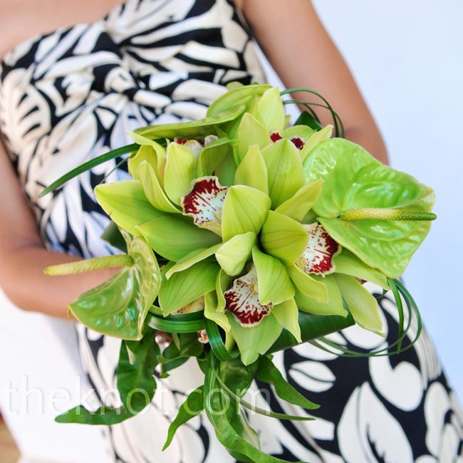 For an organic look, the bridesmaids held lily grass, anthuriums, cymbidium orchids and rolled ti leaves.