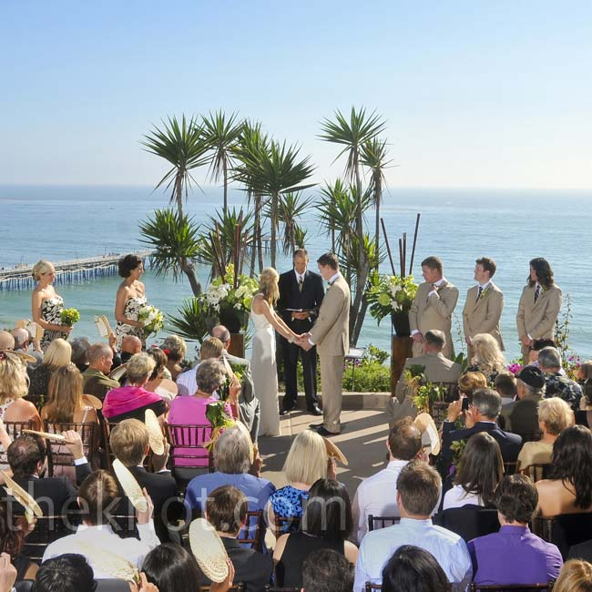 Kira and Colin exchanged vows on Casa Romantica's outdoor terrace. Two arrangements of ti leaves, succulents, anthuriums, cymbidium orchids and bamboo marked the altar.