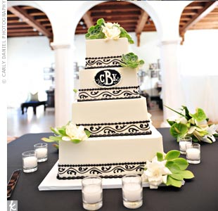Black scroll piping and a monogram decorated the buttercream cake, while succulents and gardenias finished the look.
