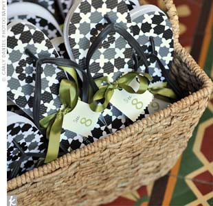 A basket of floral flip-flops encouraged female guests to ditch their heels.