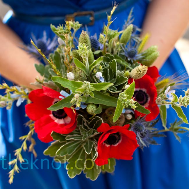 Bright-red anemones added a pop of color to the bridesmaids' thistle and wildflower bouquets.