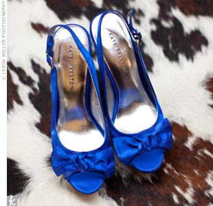 Katie knew she wanted to wear blue shoes, so when she found a pair made by designer Kate Preston (get it? Katie and Preston), that sealed the deal.